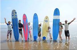 family having fun taking surf lessons