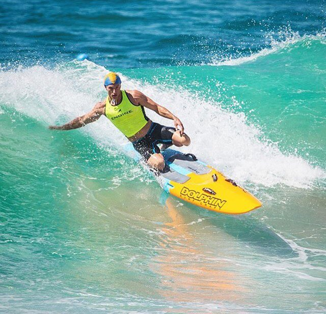 Racer on a Dolphin Surf Craft Prone Board
